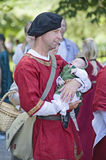 Medieval man. Visby, Gotland island / Sweden -  August 5: Traditional medieval festival with concerts, market and people dressed with medieval costumes - August Royalty Free Stock Photos