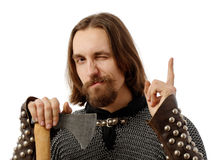 Medieval man with axe and with his finger up. Medieval man holding an axe and with his finger up Royalty Free Stock Photography