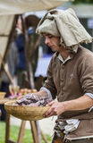 Medieval Man Preparing Food Stock Photos