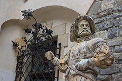 Medieval marble statue of courtier at Peles castle, Romania Royalty Free Stock Image