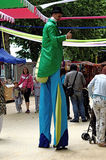 Medieval market: hatted man in a green jacket and  Royalty Free Stock Image