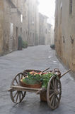 Medieval marketplace scene. Wooden cart in medieval marketplace scene in Italian Piazza royalty free stock photo