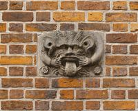 Medieval Mask. In the wall of a german town hall. These Masks were meant to scare away evil spirits. Also it was meant to demonstrate to the population that Stock Image