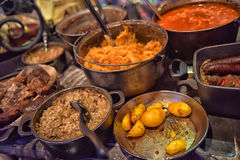 Medieval meal in boilers Royalty Free Stock Image
