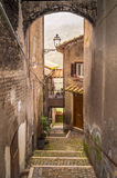 Medieval mediterranean narrow street with old houses Royalty Free Stock Images