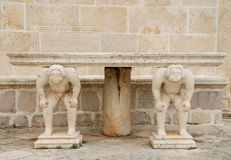 Medieval table with caryatids Royalty Free Stock Image