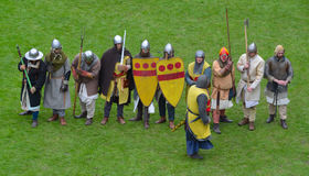 Medieval men at arms being drilled by knight. Royalty Free Stock Images
