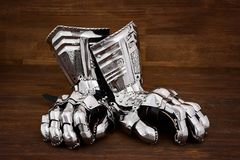 Medieval metal glove, detail of part of ancient armor. Detail of war Stock Photography