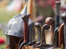 Medieval metal helmet and weapons Stock Image