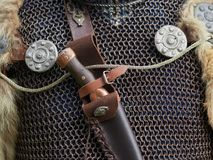 Medieval weapons. Medieval metal weapons and protection clothes Royalty Free Stock Photos
