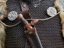 Medieval weapons. Medieval metal weapons and protective clothes Stock Images