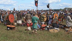 Medieval military festival Voinovo Pole (Warriors' Field). DRAKINO, RUSSIA - AUGUST 23: audience (more 10000) and participants (about 120) of medieval military stock images