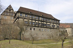 Medieval monastery, bebenhausen. View of famous walled monastery built in medieval times partly with wattle technique, shot from the road in winter light Stock Photos