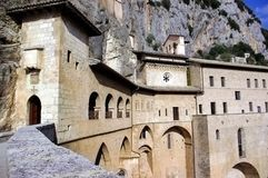 Medieval monastery building - Monastero di San Ben. An old, medieval monastery building (Monastero di San Benedetto) that was built into the rocks of an Royalty Free Stock Photos