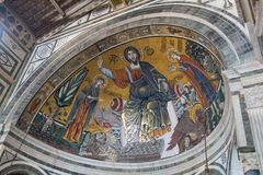 The medieval mosaic of Christ between the Virgin and St Minias in Basilica San Miniato al Monte, Florence, Tuscany, Italy royalty free stock image