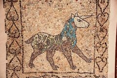 Unicorn mosaic. Medieval mosaic with the figure of an unicorn in the Basilica di S. Giovanni Evangelista, in Ferrara stock photography