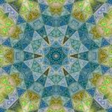 Medieval mosaic star or flower in gold, green and blue teal effect glass. Medieval mosaic star or flower in gold, green and blue teal Royalty Free Stock Image