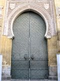 Medieval Mosque gate in Cordoba, Spain. The majestic entrance gate of the Mezquita (the Great Mosque), one of the most famous landmarks in Andalusia Royalty Free Stock Photo
