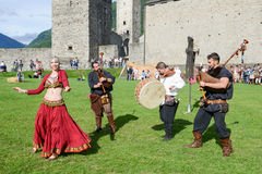 Medieval music group featuring a belly dancer at Castelgrande ca Stock Image