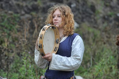 Medieval musician with a tambourine Stock Photo