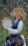Medieval musician with a tambourine Stock Images