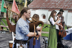 Medieval musicians at the festival Stock Photo