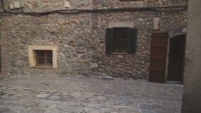 Medieval narrow cobblestone street in Valdemossa village. Mallorca, Balearic Islands, Spain stock footage