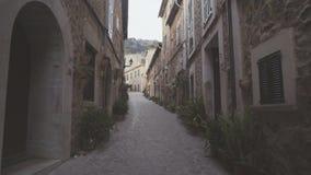 Medieval narrow cobblestone street in Valdemossa village. Mallorca, Balearic Islands, Spain stock video