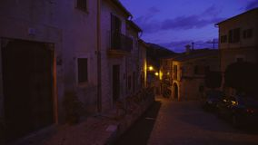 Medieval narrow cobblestone street in Valdemossa village at night. Mallorca, Balearic Islands, Spain stock video footage
