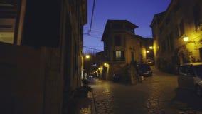 Medieval narrow cobblestone street in Valdemossa village at night. Mallorca, Balearic Islands, Spain stock video
