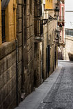 Medieval narrow streets of Alicante old town historic district Santa Cruz Stock Image