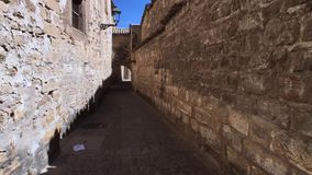 Medieval neighborhood in Baeza, alleyway with stone arch, Jaen province, Andalusia. Spain stock footage