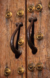Medieval oak door and bronze handles. Caceres, Spain. UNESCO World Heritage Site. Royalty Free Stock Photo