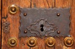 Medieval oak door and bronze lock. Caceres, Spain. UNESCO World Heritage Site. Stock Photos