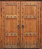 Medieval oak doors. Medieval oak door, Gothic style, the castle doors, heavy equipment, defense, knights royal chambers Stock Photos