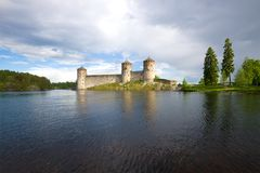 Medieval Olanvinlinna fortress and the Curensalmi strait under a thunder-storming sky. Savonlinna, Finland royalty free stock photo