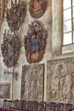 Medieval old family coat of arms hanging on the wall Stock Photography