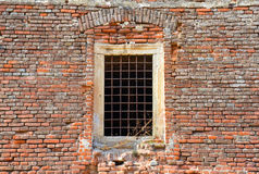 A medieval old historic window in a brick wall Stock Images