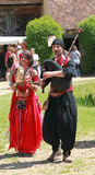 Medieval Oriental entertainers. Arville,France,May 23rd 2010: An Oriental bagpipper and a beautiful female dancer entertaining the people during the a Medieval Stock Photos