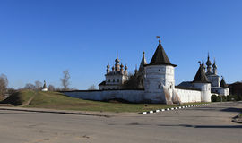 Medieval Orthodox Monastery in provincial Russian. Extant old-time architecture of white-stone Kremlin and earthen fortification rampart in Yuriev-Polsky town royalty free stock image