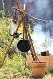 Medieval outdoor kitchen. Fire and pots Royalty Free Stock Image