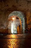 Medieval passage at night illuminated Stock Photography