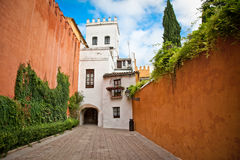 Medieval passageway in old part of Seville , Spain. Stock Photography