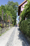Medieval paved street in Sighisoara, Transylvania Stock Photos