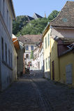 Medieval paved street in Sighisoara, Transylvania Stock Photo