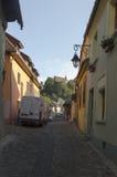Medieval paved street in Sighisoara, Transylvania Stock Image