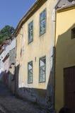 Medieval paved street in Sighisoara, Transylvania Royalty Free Stock Photos