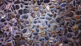 Medieval pavement made of pebbles,texture Stock Photos