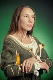 Medieval peasant. The medieval peasant woman in a green dress Stock Photo
