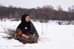 Medieval peasant with a firewood  bundle Stock Image